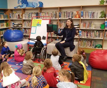 Picture of Librarian reading a book to students during Inclusive Schools week