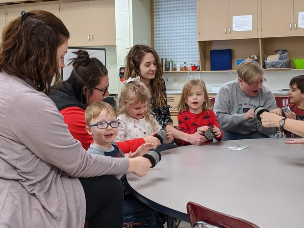 (l to r) Classroom aides Kristen Rice and Gina Dennison, intervention specialist Camille Becker and Chardon High School senior Hannah Holbert assist with Miss Carol's Tiny Toppers Preschool music lesson.
