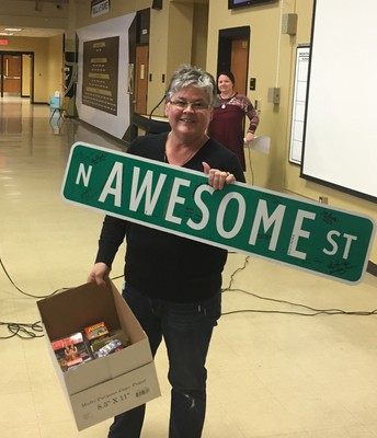 Linda Lott was given the Awesome Street Award by Dan Lamb