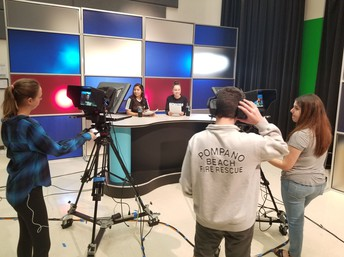 Students using video production equipment