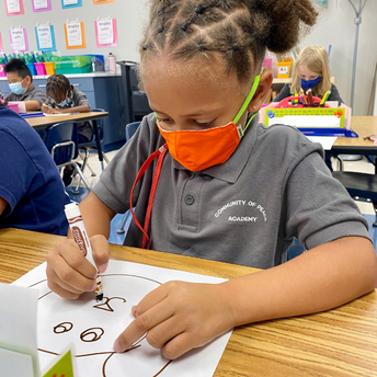 A student draws a picture.