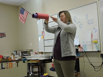 Teacher Demonstrating with paper