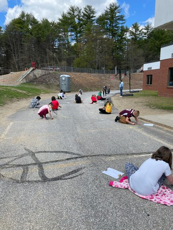 4th Grade Takes Cursive Practice Outside