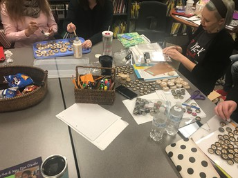 Union Pre-K and Kindergarten teachers making their own materials to increase complex levels of play with literacy components.