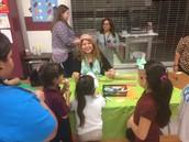 Mayra Hernandez helped students make headwear