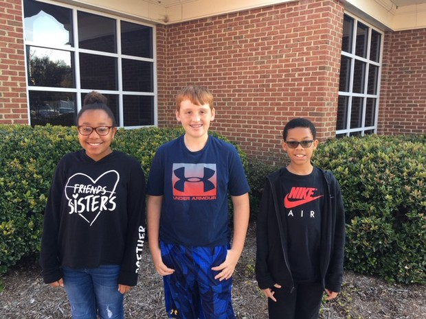Picture of three West Point Middle School students of the month