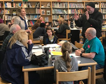 Bus drivers and students talk during bus summit