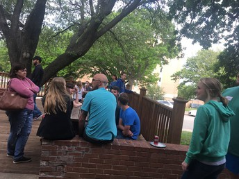 Wesley discussion group leader Lizzy McClinchie (in the green sweatshirt) prepares to facilitate a conversation with the youth to help them process the messages they heard.