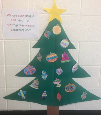 Student made Christmas Tree with saying...we are each unique and beautiful but together we are a masterpiece