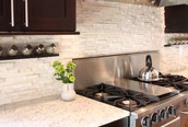 Natural Stone Counters And Light Cabinets