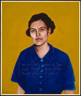 """A painting of a woman in a blue shirt. She is gazing directly at the viewer. The background of the portrait is yellow. Written on the portrait is: """"Emma Tenayuca, I was arrested a number of times. I never thought in terms of fear. I thought in terms of justice."""