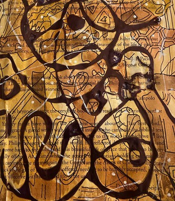 Brown abstract drawing over book page