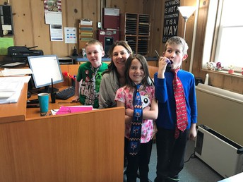Three 2nd graders chose to be principal for the afternoon!