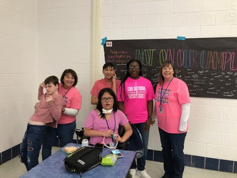image of students & faculty dressed in pink & white