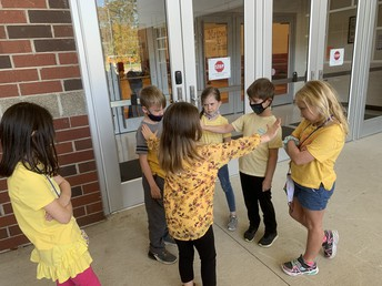 Students helping other students on World Kindness Day
