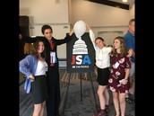 Holding  The JSA Banner