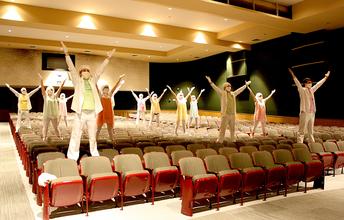 Filming a Scene in the High School Auditorium