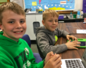 Students use iPads and laptops to answer Iowa trivia