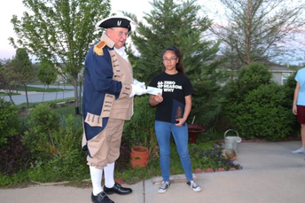 Dewey Fry presenting a $100 check to Audrey Gainer for the 2020 Winning Poster