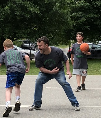 Mr. Getchell trying to relive his glory days on the basketball court at fifth grade field day.
