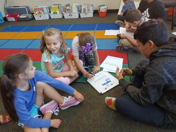 Middle Students mentoring 1st Grade Students.