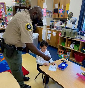 reading to Officer Washington