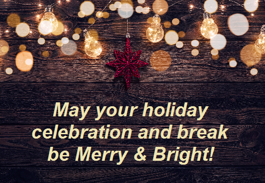 """Festive wooden background with the message, """"May your holiday celebration and break be merry & bright!"""""""