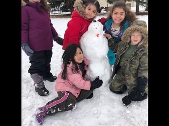 Building snow people in Kindergarten.