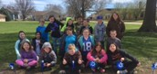 Miss Wild's Class poses with their pinwheels