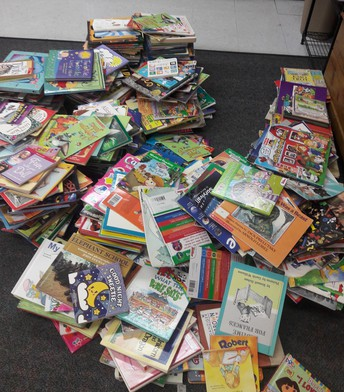 Classroom Materials and Library Book Pick Up This Thursday!
