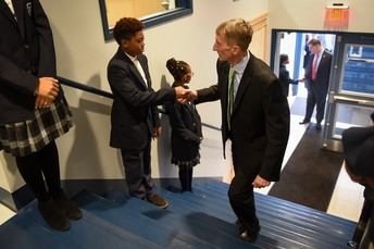 Student Ambassador, Jason from grade 7, welcomes Commissioner Evans!