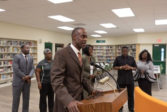 A photo of Superintendent Runcie speaking at Blanche Ely High School's media center ribbon cutting