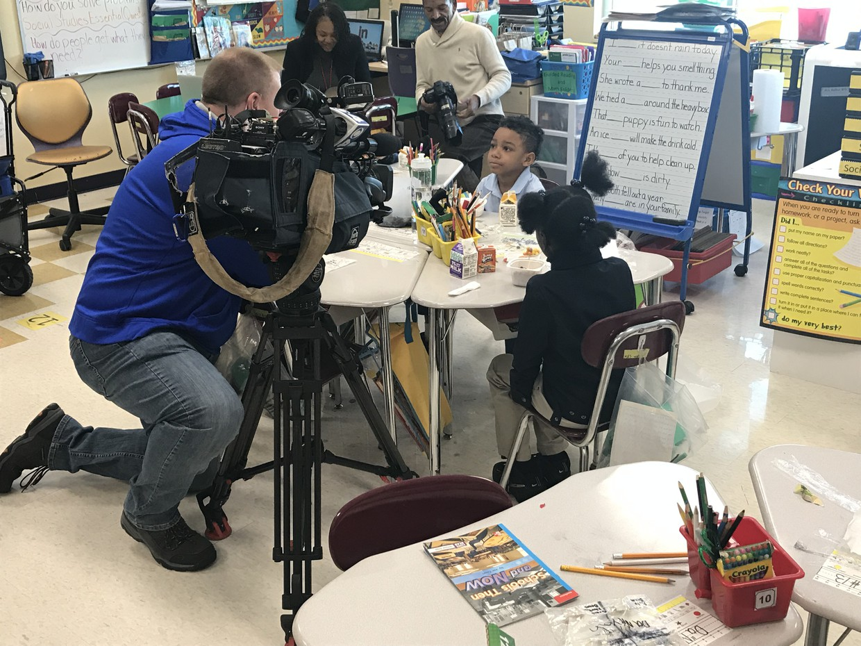 A reporter interviews a student at Barack Obama Elementary School.