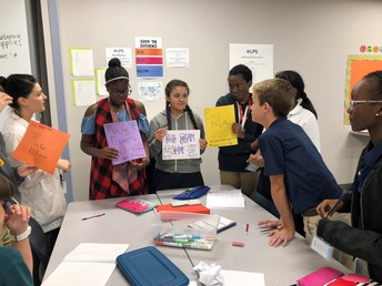 7th grade students working on marketing their slime for the carnival.