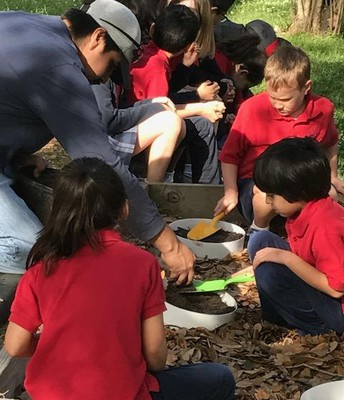Eager Students Busily Planting their Cylinder Gardens!