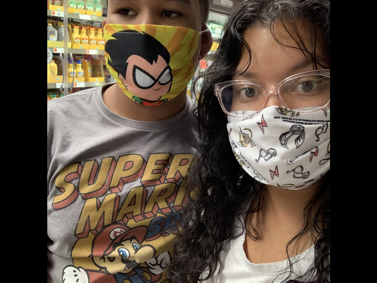 boy wearing Mario tshirt and mask at grocery store with Mom (wearing mask)