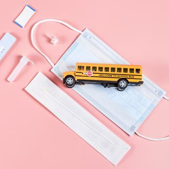 School Bus Toy Sitting on Mask