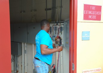 Electrician working on the fire alarm system