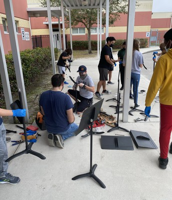 """Barrington Middle school """"stands up"""" for music! Mr. Rosa and his students created a project to repair music stands and donate them to schools in need! Thank you Barrington for spreading the love and the music!"""