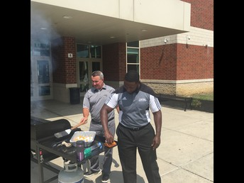 Mr. Parker and Mr. Nickel were the grill masters for the teacher's back to school lunch.