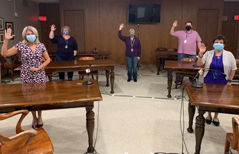Special Education personnel holding their hands up