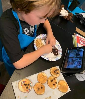 Lucian W. making apple cookies