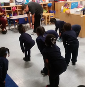 PreK-B loves to stretch...their muscles and their brains!