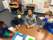 5th graders reviewing their concepts with their fidgets.