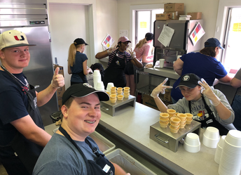 Students in band volunteering at the Dairy Barn
