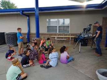 Mr. Welker teaching the Woodworking club