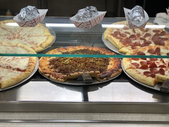 Variety of pizza offered daily.