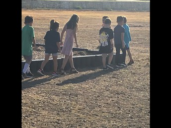 Walking and Measuring the playground perimeter.