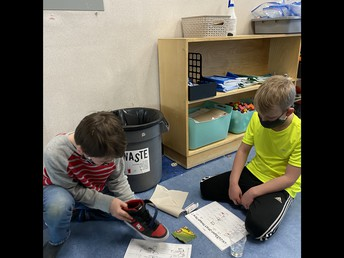 2L is learning if a magnet's force can pass through materials.