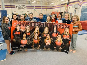 CHS Gymnastics Team with team banner by Pastor Photography